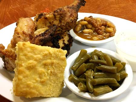 Big Bob Gibson's half Chicken w/Alabama White Sauce on the side - served with choice of 2 Sides & Cornbread.